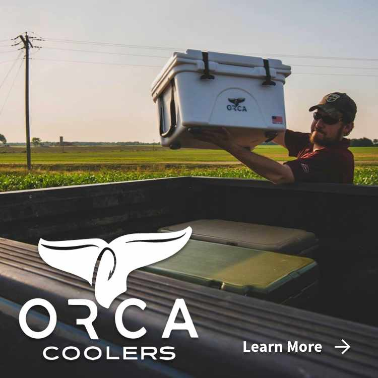 Orca logo with man putting Orca cooler in back of truck