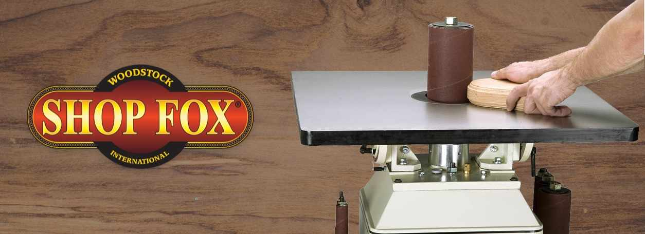 Shop Fox logo with woodworking machinery